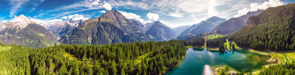 Foto op Canvas Alpen Arnisee with Swiss Alps. Arnisee is a reservoir in the Canton of Uri, Switzerland, Europe