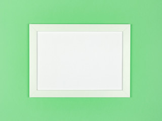 Picture frame flat lay on textured pastel colored paper background