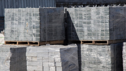 Pallets with concrete decorative pavement tiles