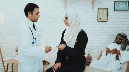 Muslim Woman Holding Pregnancy Test in Hospital