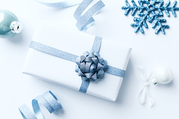 Christmas present with Christmas decorations on white background. Flatlay. Copy space