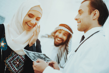 Happy Pregnancy Muslim Woman Hold Ultrasound Image