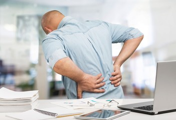 Business man with back pain an office