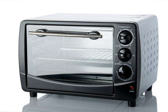 Cooking: Close up of Black Colored Oven Isolated on White Background