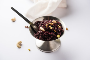 Beetroot Halwa garnished with Pistachio served in a bowl, selective focus