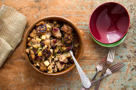 Overhead view of apple and cranberry stuffing in bowl