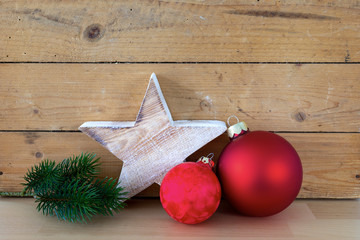Typical Christmas symbols decoration on a wooden background