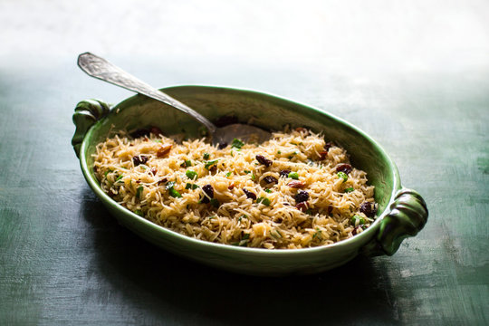 Pilaf with raisins and almonds served in casserole