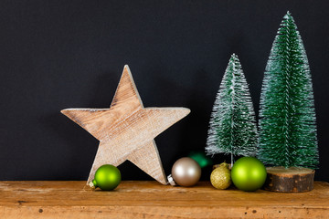 Christmas decoration black background with tree glass balls and star