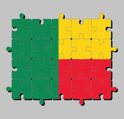 Jigsaw puzzle of Benin flag in A horizontal bicolor of yellow and red with a green vertical band. Concept of Fulfillment or perfection.