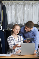 Couple Running On Line Fashion Business Working In Warehouse