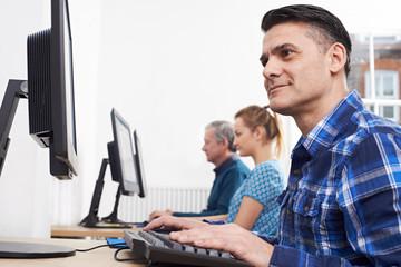 Mature Man Attending Computer Class In Front Of Screen