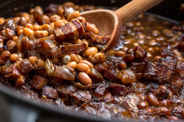Close up of baked beans and fresh ham with maple balsamic