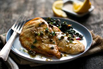 Close up of chicken, lemon and garlic chicken with mushrooms
