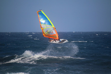 Windsurfer jumping in the waves of the Atlantic ocean