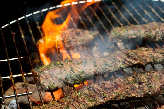 Close up of grilled skirt steak grilling on barbecue grill