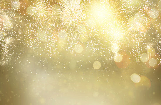 Abstract festive winter glittering bokeh background with fireworks and bokeh lights