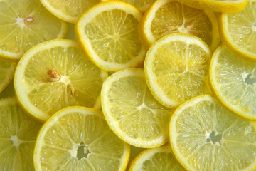 A background of slices of lemon