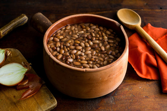 Close up of pinto beans soaked in a bowl of water