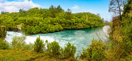 The powerful force of flowing and raging water of the Waikato River. Landscape at Huka Falls near Taupo, North Island, New Zealand.