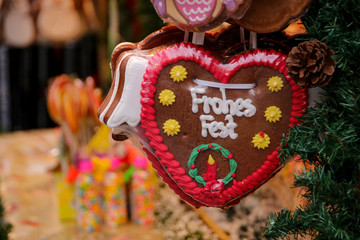 Gingerbread heart with Happy Holiday in German at a Christmas market