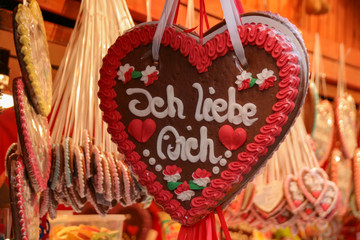 Gingerbread heart with I love you in German at a Christmas market