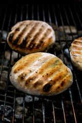 Close up of grilled flatbread on barbecue grill