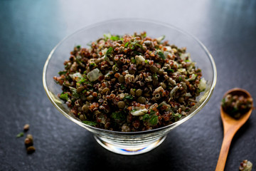 Close up of quinoa and lentil pilaf served in a bowl on table