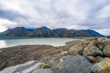 Tasman Glacier and lake with massive icebergs, pieces of melting ice. Aoraki / Mount Cook National Park, New Zealand.