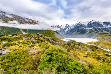 Amazing beautiful landscape at Hooker Valley Track, a breathtaking place in Aoraki, New Zealand. It is a famous tourist attraction surrounded by alpine mountain meltwater streams, glacier and lakes.