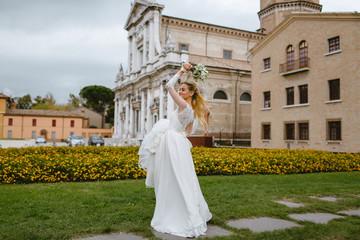 The bride in the wedding dress turns around.