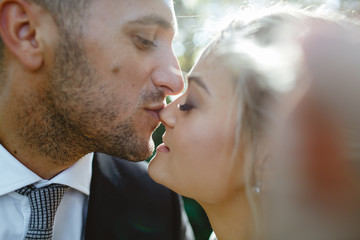 A couple kisses.