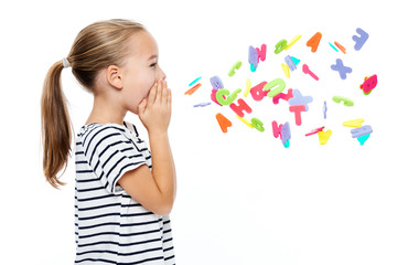 Cute little girl in stripped T-shirt shouting out alphabet letters. Speech therapy concept over...