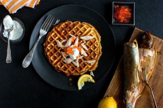 Overhead view of potato waffles with smoked trout