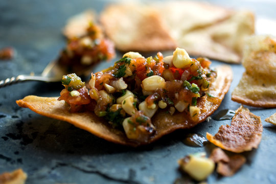 Close up of roasted corn and tomato salsa