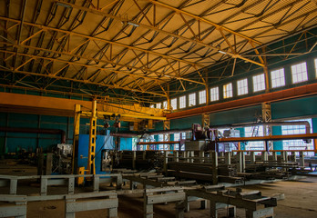 Shop perforation spars at the production site of an industrial plant. Metal processing machine. Blacksmith auto parts manufacturing