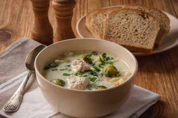 Creamy soup with vegetables and turkey meatballs.