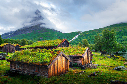 Typical norwegian old wooden houses with grass roofs in Innerdalen - Norway's most beautiful mountain valley, near Innerdalsvatna lake. Norway, Europe. Autumn time