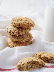 oatmeal cookies and milk on white background. Rustic style.