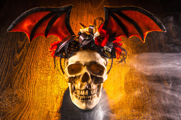 Skull. The skull is decorated with wings. Death. Feast of the dead. Halloween The wings of the bat.