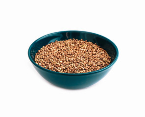 Cannabis seeds in a blue bowl, isolated on white background. Marijuana grains in a plate, herbal health treatment.