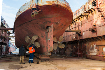 Ship in the dock. Repair of the ship in the floating dock, replacement of the screw.