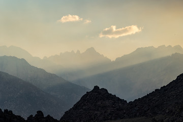 Mt Whitney, the highest point in the lower 48 states in the United States, is covered in smoke and haze due to nearby wildfire