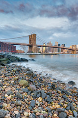 Manhattan Skyline from Pebble Beach in Brooklyn, United States.
