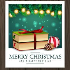 Photo with Christmas books and merry Christmas greetings
