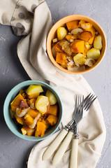 Salad of baked vegetables of pumpkins, potato, onion
