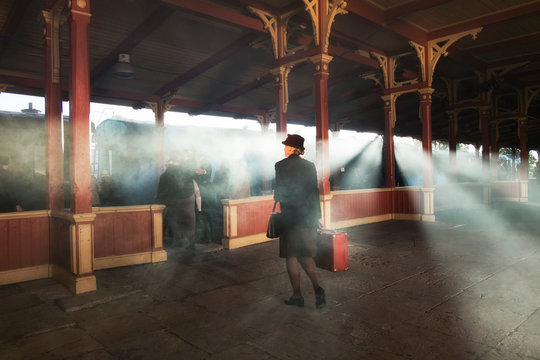 retro railway station and smoke of train