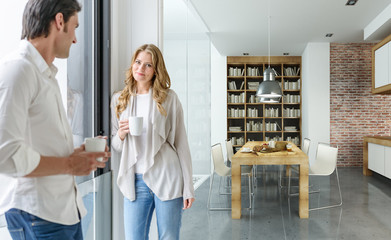 Couple having coffee in a modern house