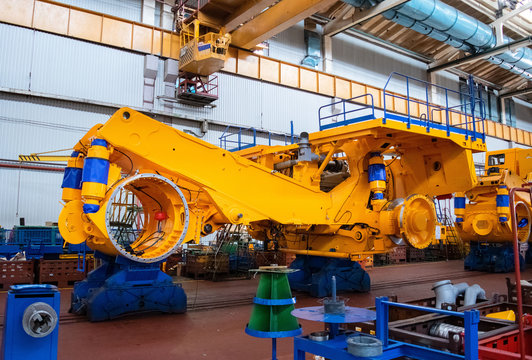 Line, conveyor for the production of large yellow trucks, mining trucks. Shop factory. Belaz is a Belarusian manufacturer of haulage and earthmoving equipment, dump trucks, haul trucks, heavy equipm