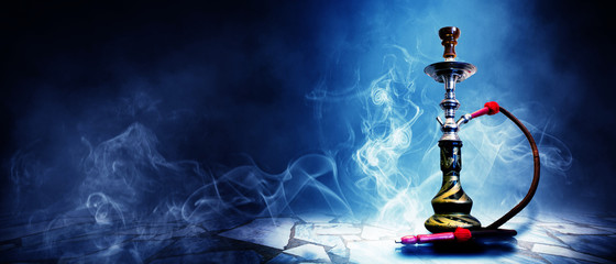 Hookah on a dark abstract background, smoke, fog, neon, concrete, rays